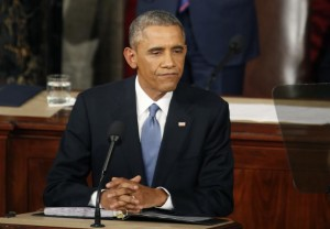 During a pause in his speech, Obama rests after declaring he would veto Republican efforts...