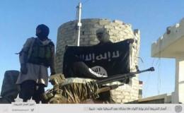 AQAP raises black flag over military camp it captured in Yemen on Thursday.