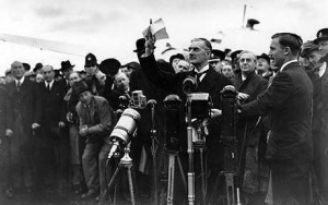 """Neville Chamberlain brandishes the paper that he believed signified """"peace for our time"""" on his return from Munich in 1938"""