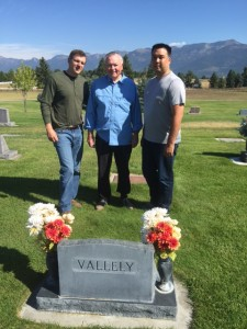 "James O'Keefe and James ""Sarge"" Olsen visit the grave of Paul Vallely's son Scott. The Major General is in the middle, with James on the left and ""Sarge"" on the right."
