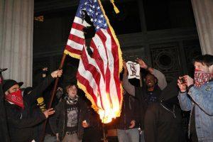 120129-occupy-oakland-goons-burn-american-flag